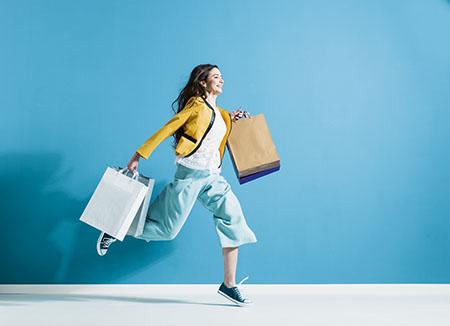 Woman running while shopping, impulse buying