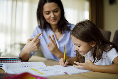 Mother or tutor teaching her child financial lessons
